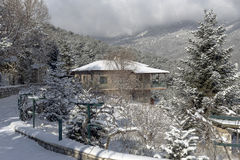 Stone house in the mountains. In winter on a sunny day Royalty Free Stock Photography