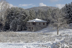 Stone house in the mountains. In winter on a sunny day Stock Image