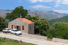 Stone house near mountain road. Zerubia. Rural landscape of South Corsica, old stone house near mountain road. Zerubia village, France royalty free stock photo