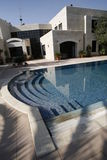Stone house and pool. Picture of a stone hose and a pool Stock Photos