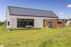 Stone house in quite countryside. View of modern stone house in a nice and quite countryside royalty free stock photography