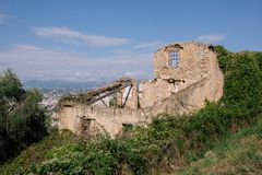 Stone house ruins on the wall in the southern European city stock image
