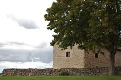 Stone house from 1100 t. Beautiful stone house and stone wall near the, monastery in Vreta Stock Photo