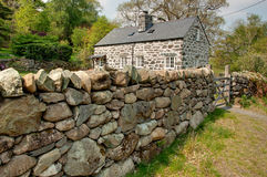 Stone house with wall Royalty Free Stock Photos
