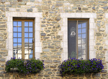 Stone house windows Royalty Free Stock Photo