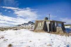 Stone house in the winter  Mountain Stock Images