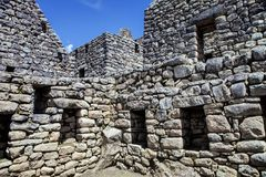 Stone houses, Machu Picchu, Peru. Ingeniously stacked stones on houses, Machu Picchu, Peru Royalty Free Stock Photo