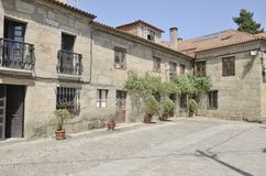 Stone houses in a plaza Royalty Free Stock Image