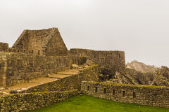 Stone houses without roofs in the lost Inca city Royalty Free Stock Photography