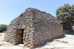 Stone hut in the Bories village in Provence, France royalty free stock photo