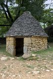 Stone hut in Breuil, France royalty free stock image
