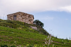 Stone hut on hillside, Sicily, Italy Stock Images