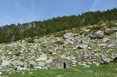 Stone hut in the mountains Stock Photography