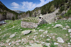 Stone hut near the tourist trail in the mountains Royalty Free Stock Images