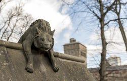 Stone Hyena statue against the sky Stock Photos