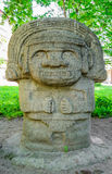 Stone idol. The Attraction Of St. Petersburg. Stone idol in the courtyard of the Museum. An old copy of the sculpture of the Indians of Central America Stock Photo