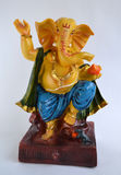 Stone Idol of Indian God Ganesha. Who has the head of an elephant and a pet mouse Royalty Free Stock Photo