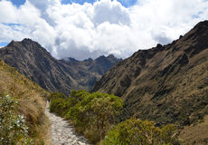 Stone Inca Trail Path in the Andes. Ancient Stone Inca Trail Path in the Andes Leading to Machu Picchu With Cloudy Sky in the Background stock photos