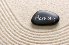 Stone with the inscription Harmony. Black stone with the inscription Harmony Stock Photos