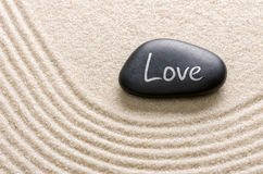 Stone with the inscription Love. Black stone with the inscription Love royalty free stock photo