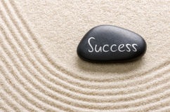 A stone with the inscription Success. Black stone with the inscription Success stock image