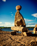 Stone Inuksuk on the Ottawa River. A pile of stacked rocks - an Inukshuk - stands on the shore of the Ottawa River in Ontario Canada Royalty Free Stock Photo