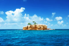 Stone island at Seychelles. On a sunny day Royalty Free Stock Photos