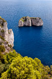 Stone islands and cliff on Capri coast Stock Photos