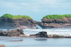 Stone Islands and cliffs on the coast of the island, indonesia, bali stock photo