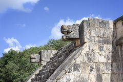 Stone jaguar head statue at the Platform of the Eagles and Jaguars in Mayan Ruins of Chichen Itza, Mexico Royalty Free Stock Photography
