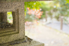 Stone Japanese temple in a garden. Royalty Free Stock Photography