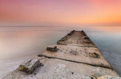 Stone jetty and calm seas Royalty Free Stock Photo