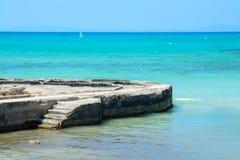 Stone jetty horizon Stock Images