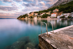 Stone Jetty in Small Village near Omis at Dawn, Dalmatia Stock Photo