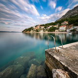 Stone Jetty in Small Village near Omis at Dawn, Dalmatia Royalty Free Stock Photo