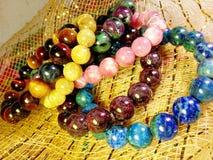 Stone jewelry. Lucky stone bracelets. Rutite quartz. Rhodochrosite. Tiger-eye. Ruby soyside. Azurite. Garnet Stock Images