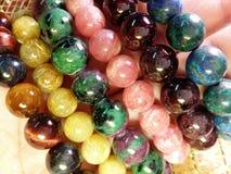 Stone jewelry. Lucky stone bracelets. Rutite quartz. Rhodochrosite. Tiger-eye. Ruby soyside. Azurite. Garnet Royalty Free Stock Photo