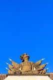 Stone knight armor statue on a roof under blue sky Royalty Free Stock Image
