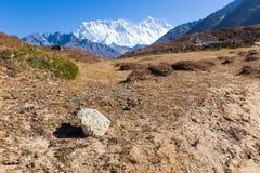 Stone and Kongde Ri mountain ridge snow peaks. Stock Images