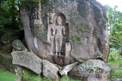 Stone with Kustoraja. Old rock-carved figure Kustoraja near Weligama, Sri Lanka Royalty Free Stock Images