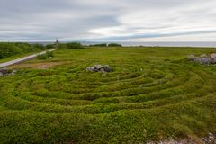 Circles of stones overgrown with mosses. Stone labyrinths on the Bolshoy Zayatsky Island. Solovetsky archipelago, White Sea, Russia royalty free stock images
