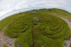 Snake Curled - Stone Maze. Stone labyrinths on the Bolshoy Zayatsky Island. Solovetsky archipelago, White Sea, Russia royalty free stock photos