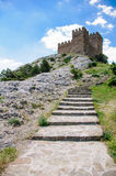 The stone ladder conducting in fortress at mountain top Royalty Free Stock Images