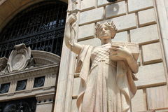Stone lady holding treasury box. Royalty Free Stock Photography