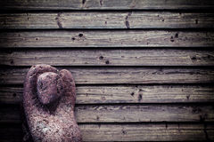 Stone Lady Sculpture on Wooden Wall Stock Image