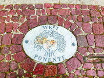 A stone laid in St Peter`s Square at Vatican City, by Bernini points in the direction of West. Royalty Free Stock Image