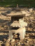 stone-lamp-on-bedrock Royalty Free Stock Photo