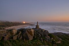 Stone landmark on the cliff top on the beach royalty free stock photography