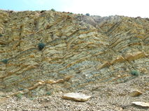 Stone landscape. A beautiful cliff. Rock breed. Summer and the sun. Blue sky. Stone landscape. A beautiful cliff. Rock breed. Summer and the sun Stock Image