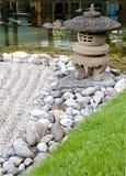 A stone lantern. Fragment of the zen garden Royalty Free Stock Photos